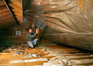 A radiant barrier installed in a Lexington attic